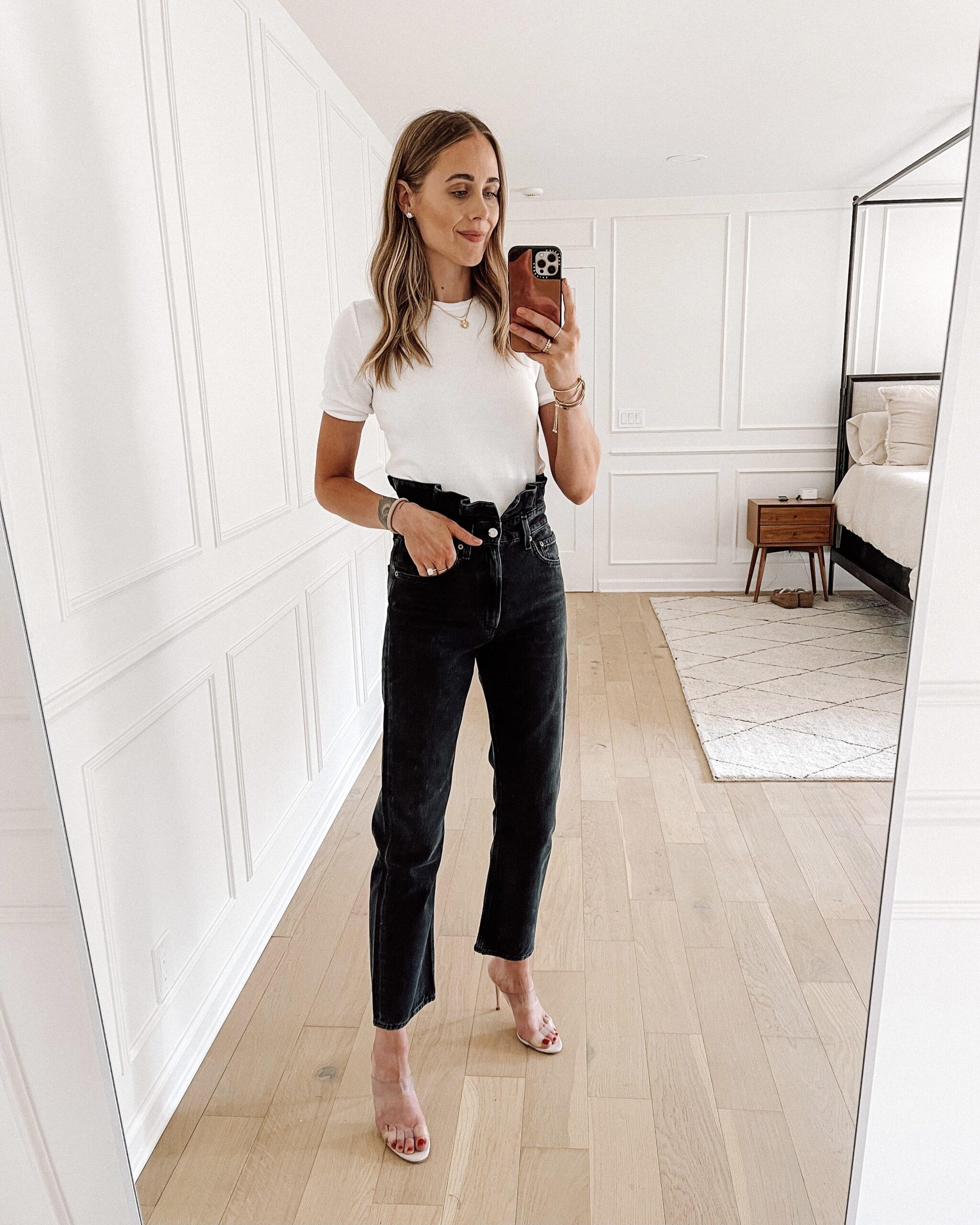 Fashion Jackson Wearing White Top AGOLDE Black Ruffle Waist Jeans Clear Heeled Sandals