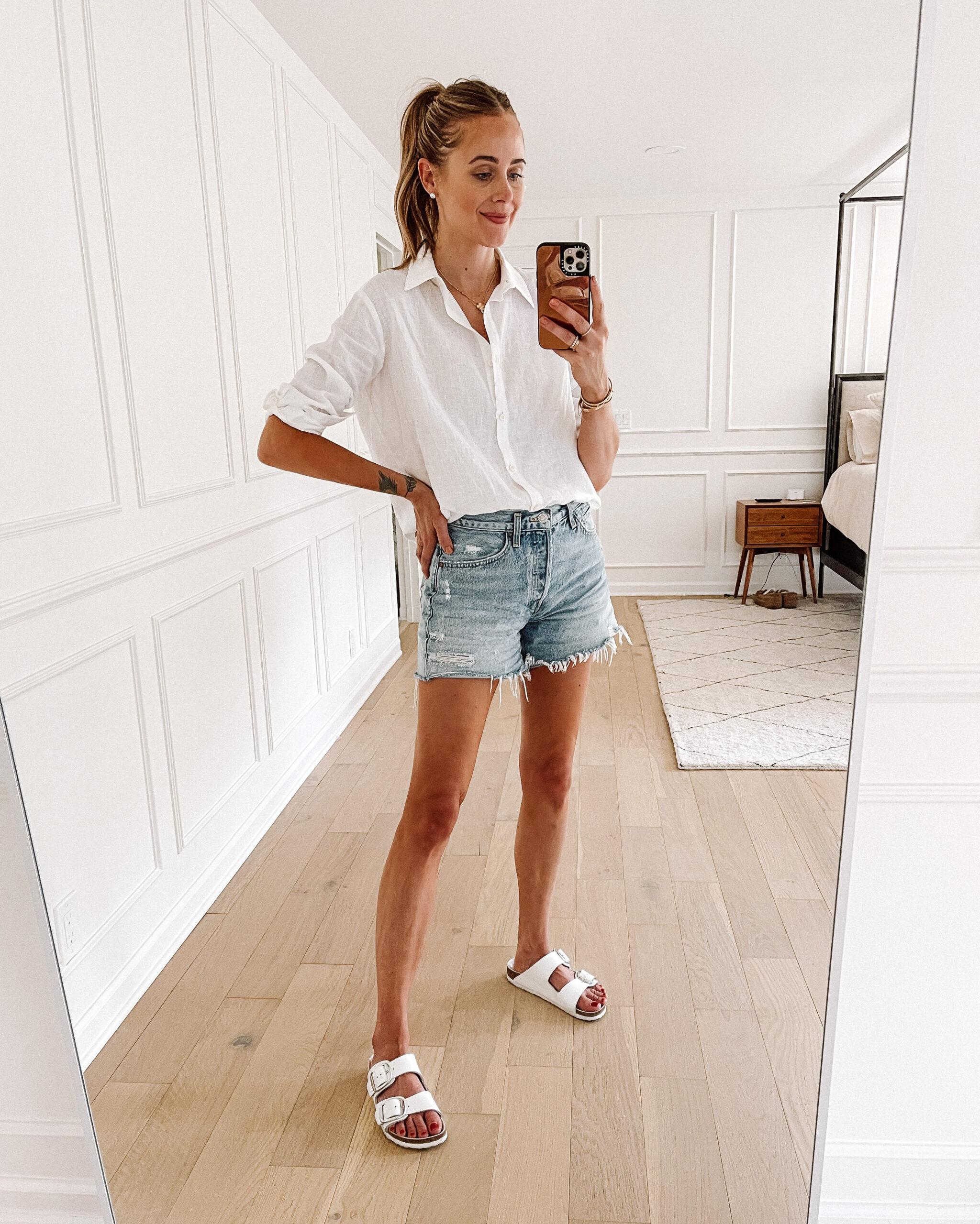 Fashion Jackson Wearing White Linen Button Down Shirt AGOLDE Parker Long Denim Shorts White Birkenstock Sandals