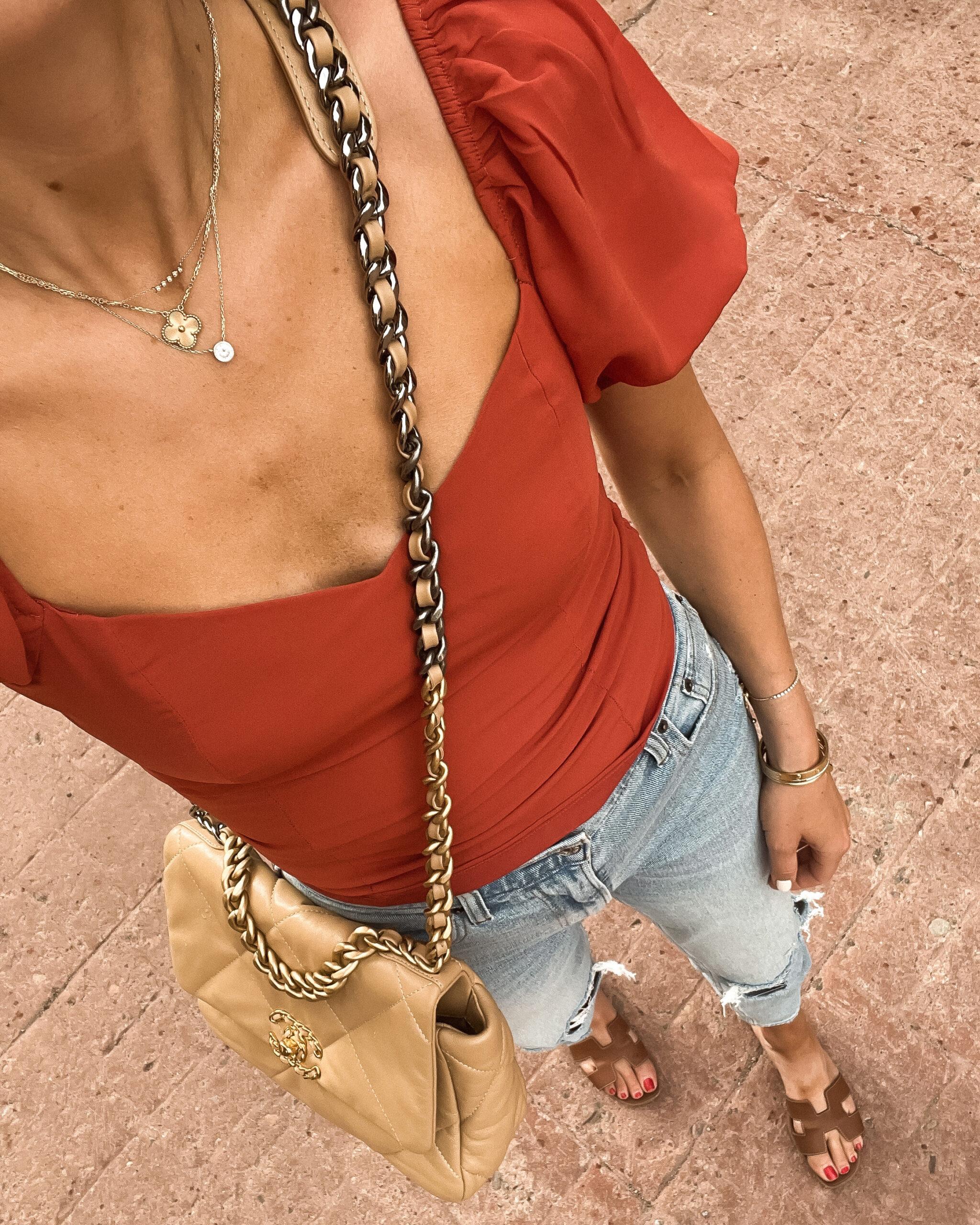 Fashion Jackson Wearing Aberceombie Red Puff Sleeve Top Abercombie Ripped Jeans Hermes Oran Tan Sandals Chanel 19 Beige Handbag