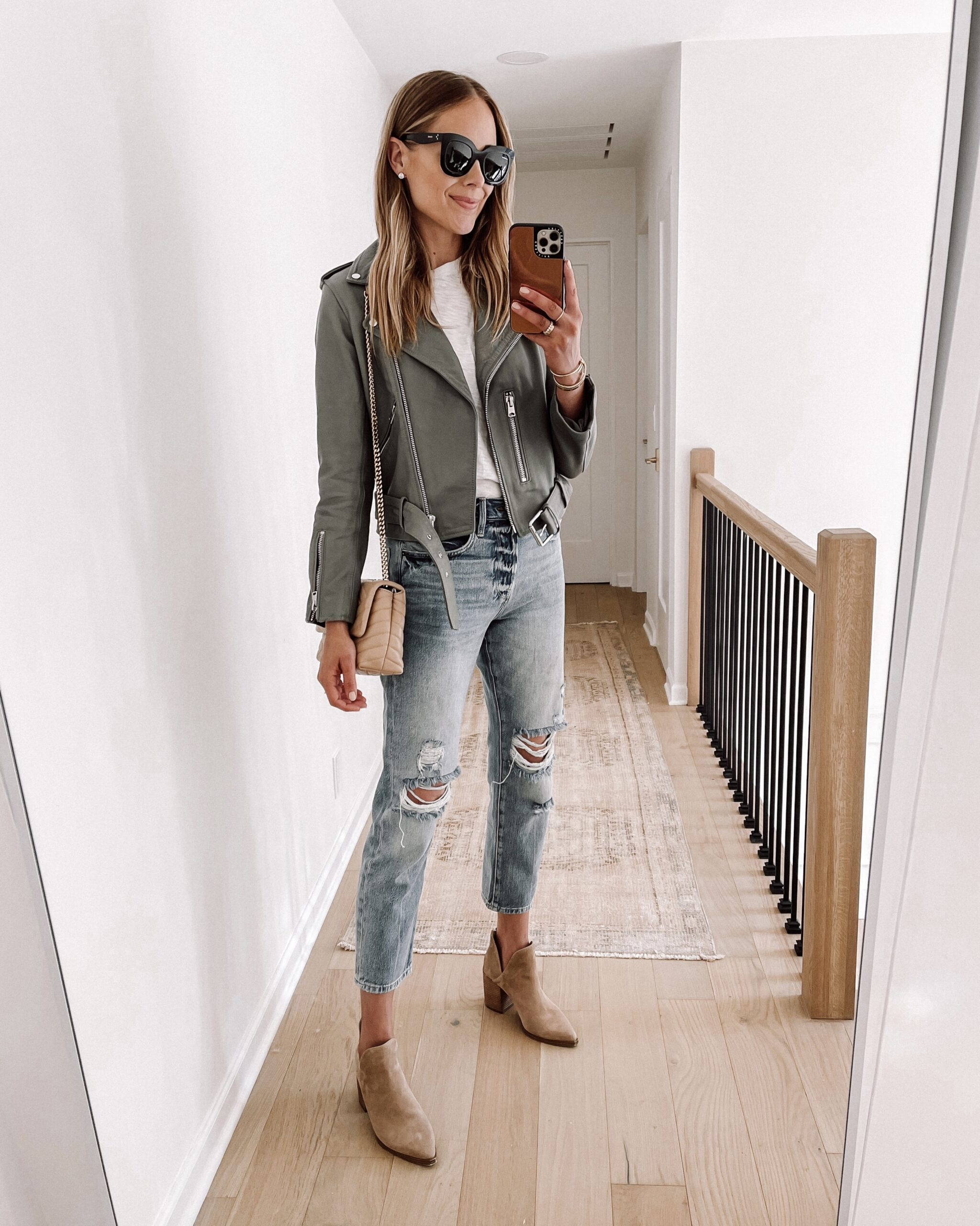 Fashion Jackson Wearing Allsaints Green Leather Jacket White Tshirt Frame Ripped Jeans Tan Suede Booties Womens Fall Shoe Trends