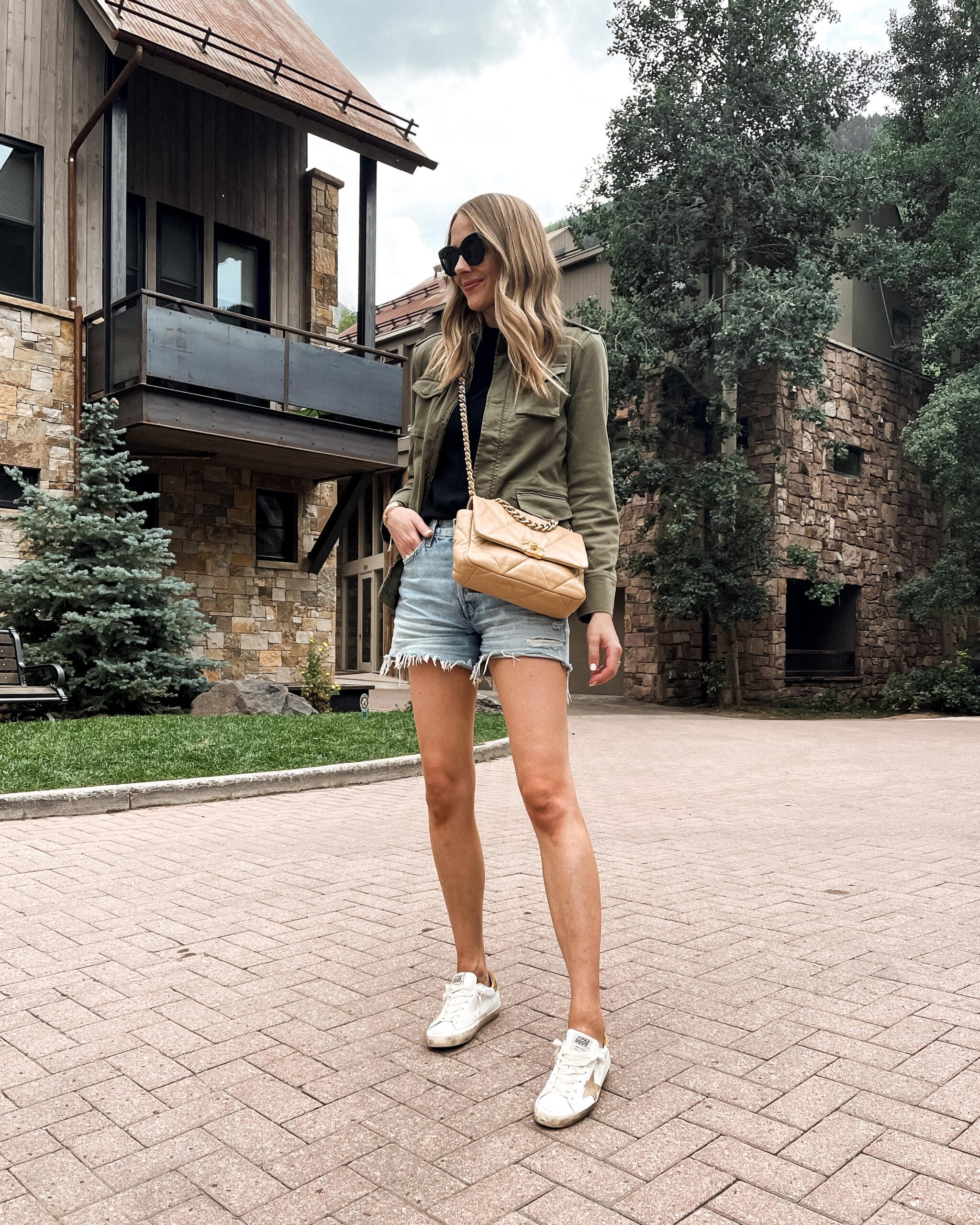 Fashion Jackson Wearing Anine Bing Green Utility Jacket AGOLDE Denim Shorts Golden Goose Sneakers Chanel 19 Beige Handbag