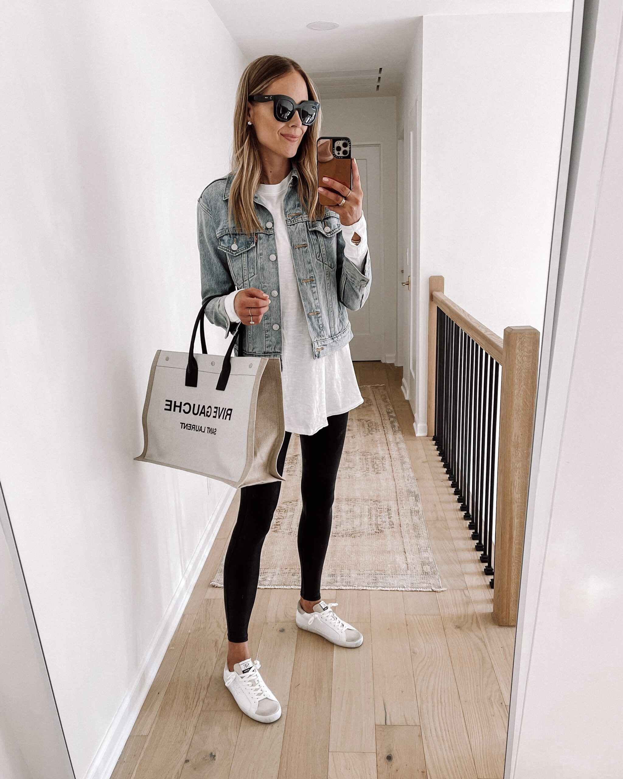 Fashion Jackson Wearing Denim Jacket White Tunic Tshirt Spanx Faux Leather Leggings Sam Edelman Aubrie White Sneakers Womens Fall Shoe Trends