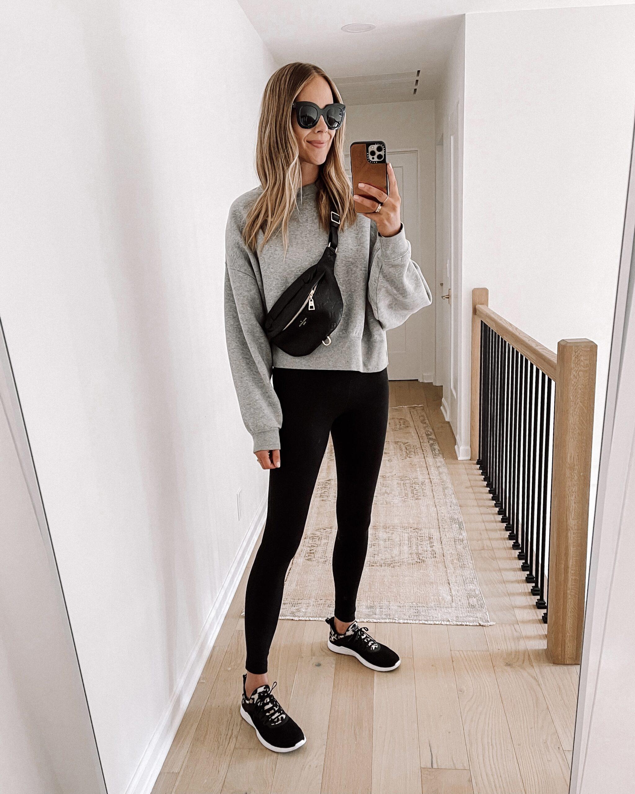 Fashion Jackson Wearing Grey Nike Sweatshirt Black Leggings Black APL Sneakers Black Louis Vuitton Bumbag Womens Fall Shoe Trends