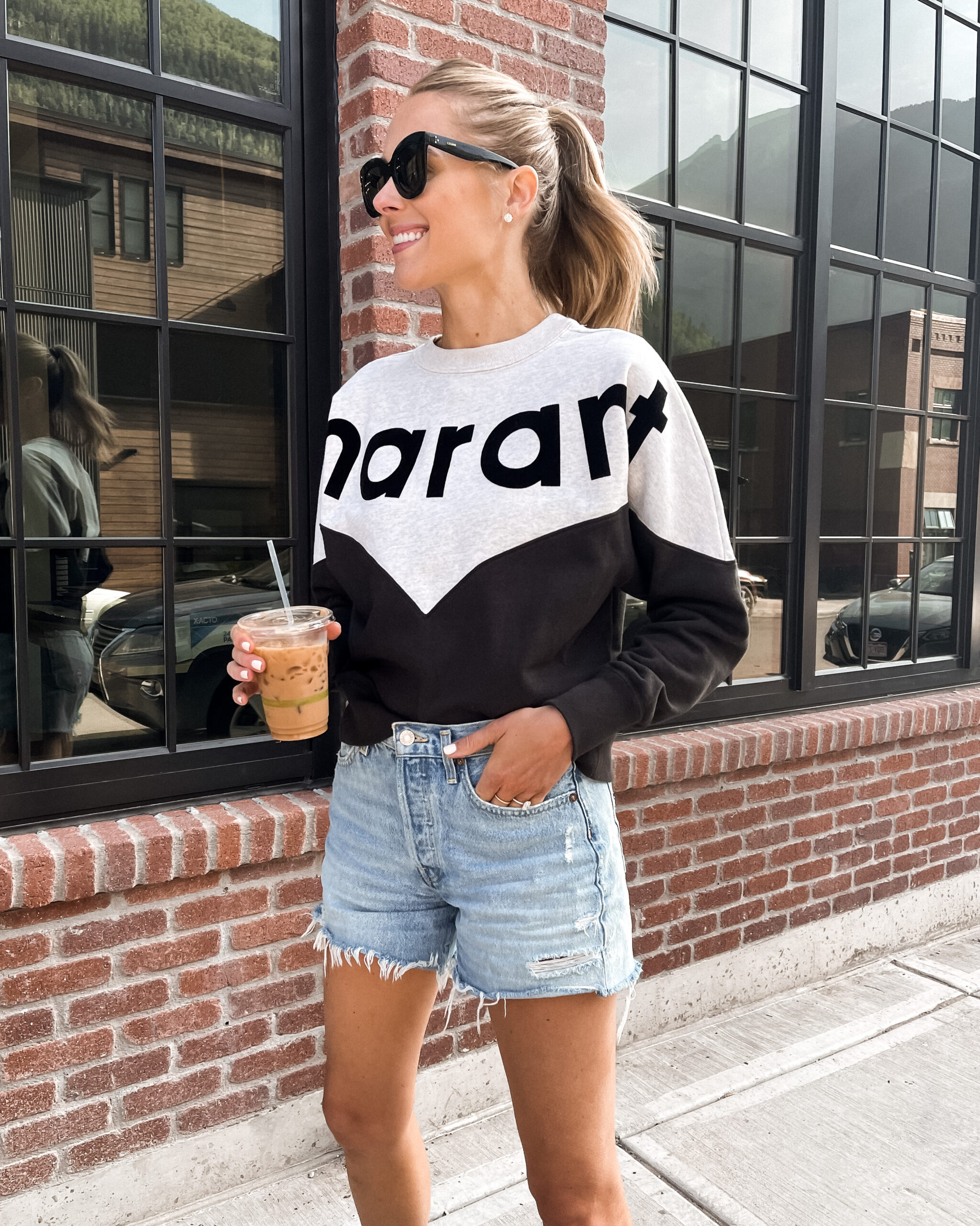 Fashion Jackson Wearing Isabel Marant Logo Sweatshirt AGOLDE Parker Long Denim Shorts Telluride Summer Outfit