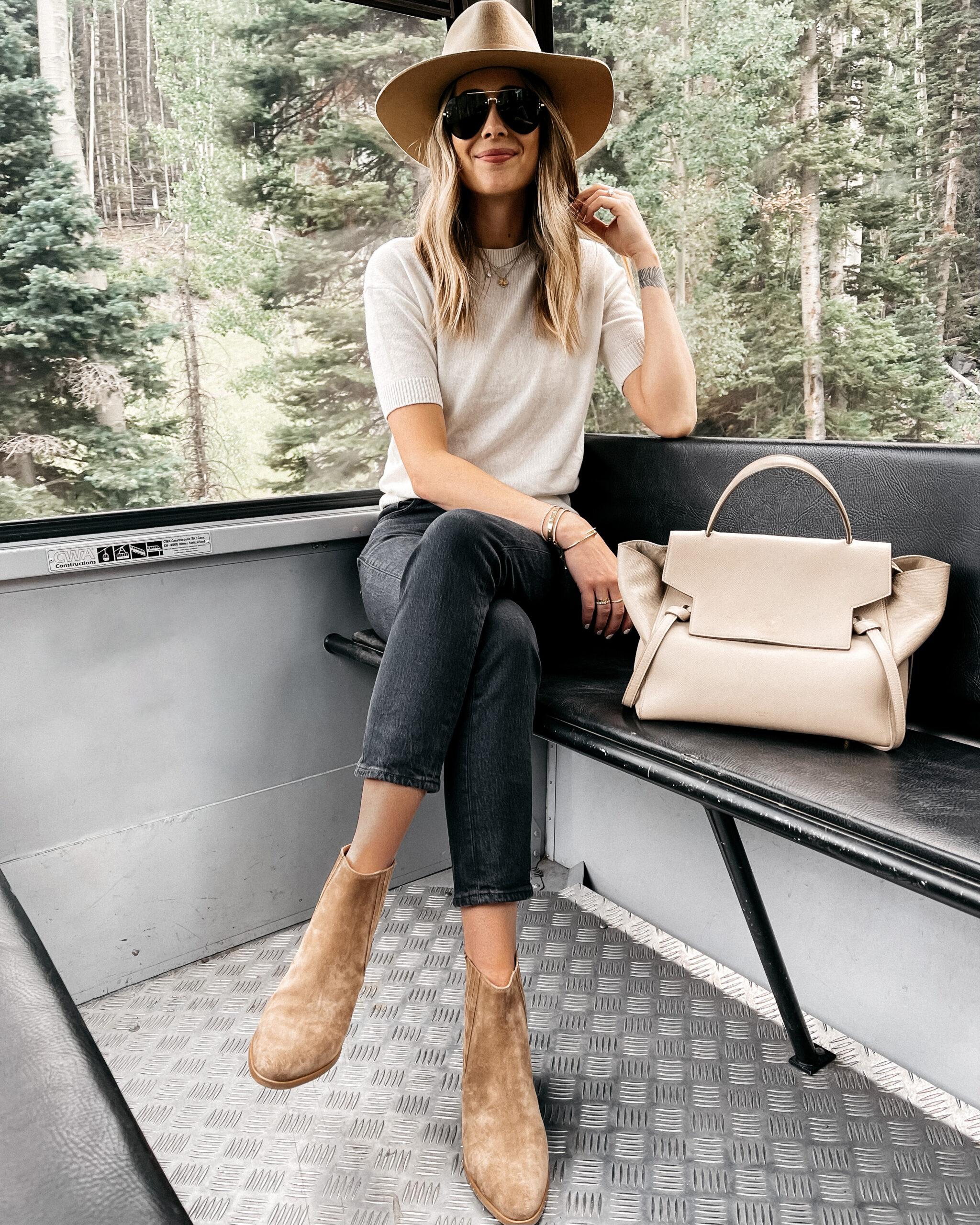 Fashion Jackson Wearing Tan Wool Hat White Short Sleeve Sweater Black Jeans Tan Suede Booties Celine Mini Belt Bag