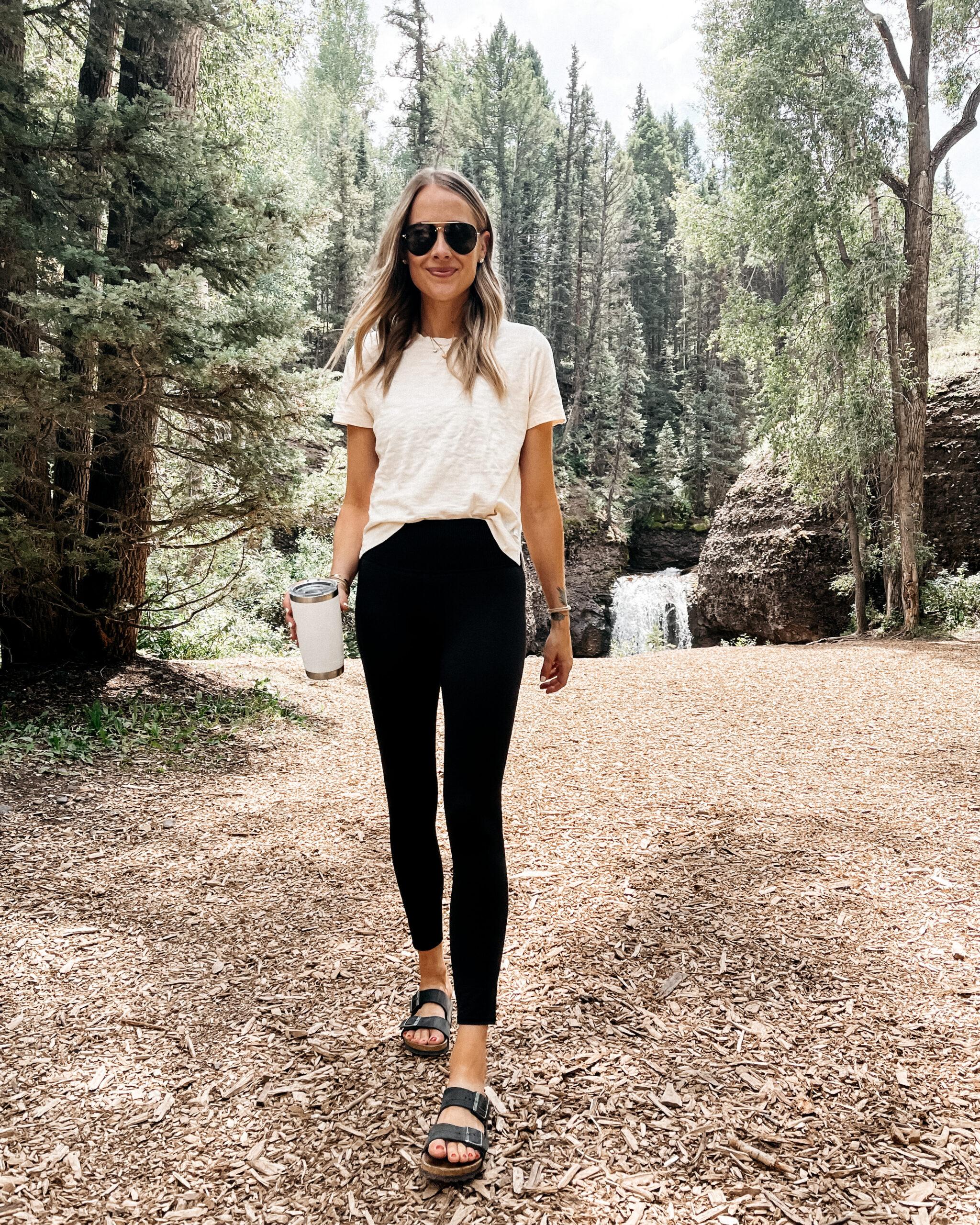 Fashion Jackson Wearing Vuori Beige Tshirt Vuori Black Leggings Black Birkenstock Sandals Telluride Outfit