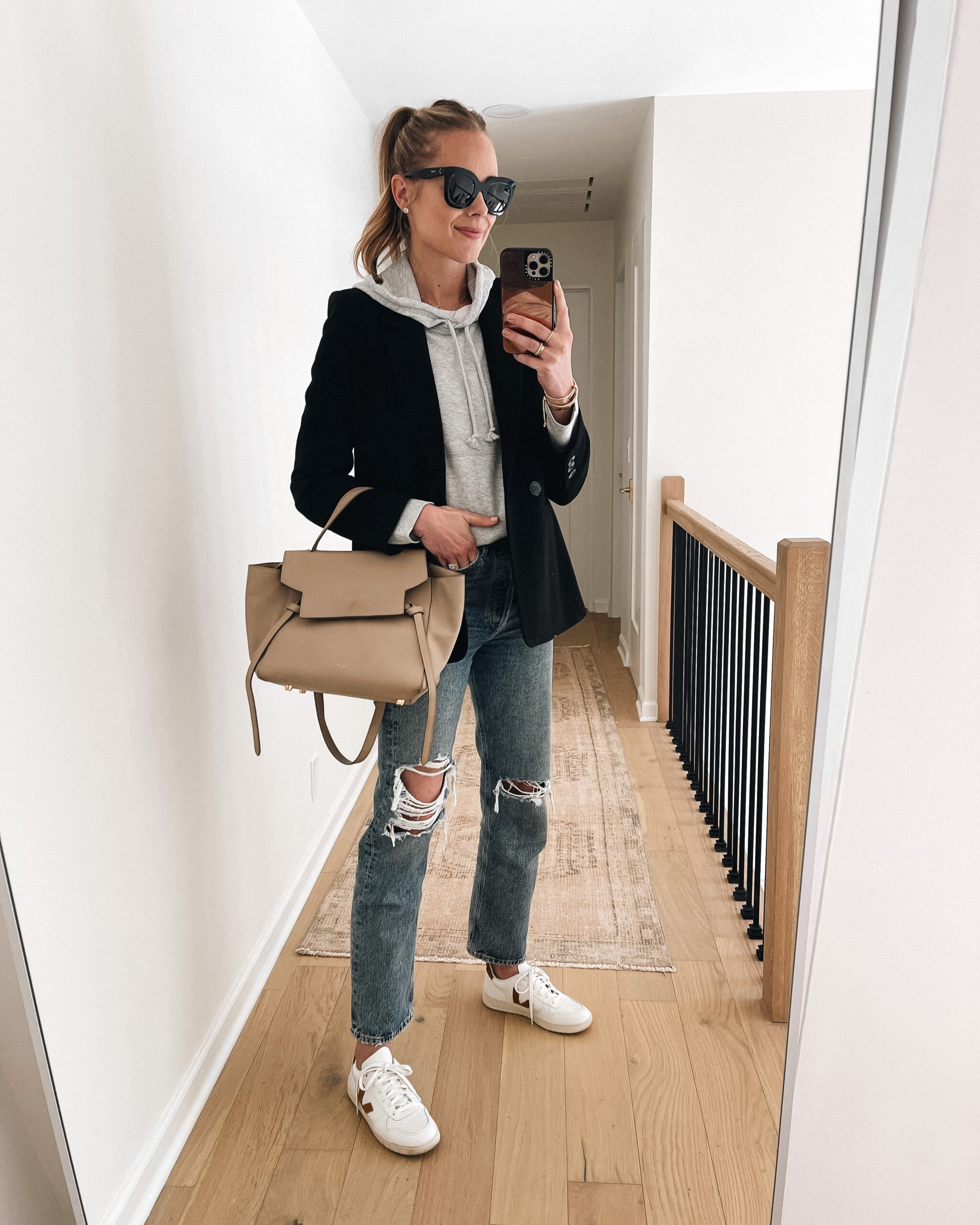 Fashion Jackson Wearing Black Blazer Grey Hoodie Sweatshirt AGOLDE Ripped Jeans Veja Sneakers Celine Mini Belt Bag
