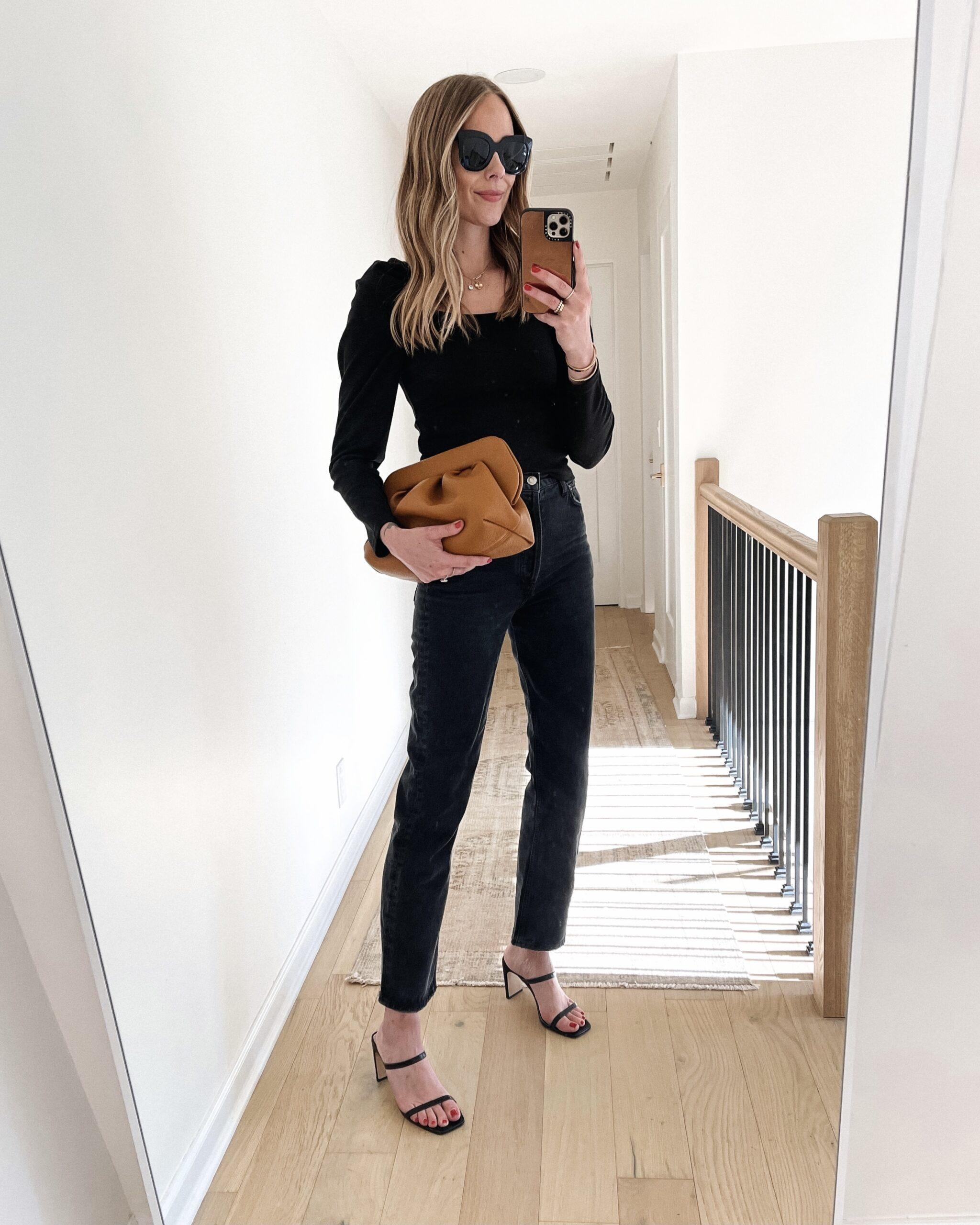 Fashion Jackson Wearing Black Puff Sleeve Top Black Jeans Black Heeled Sandals Themoire Tan Clutch Bag