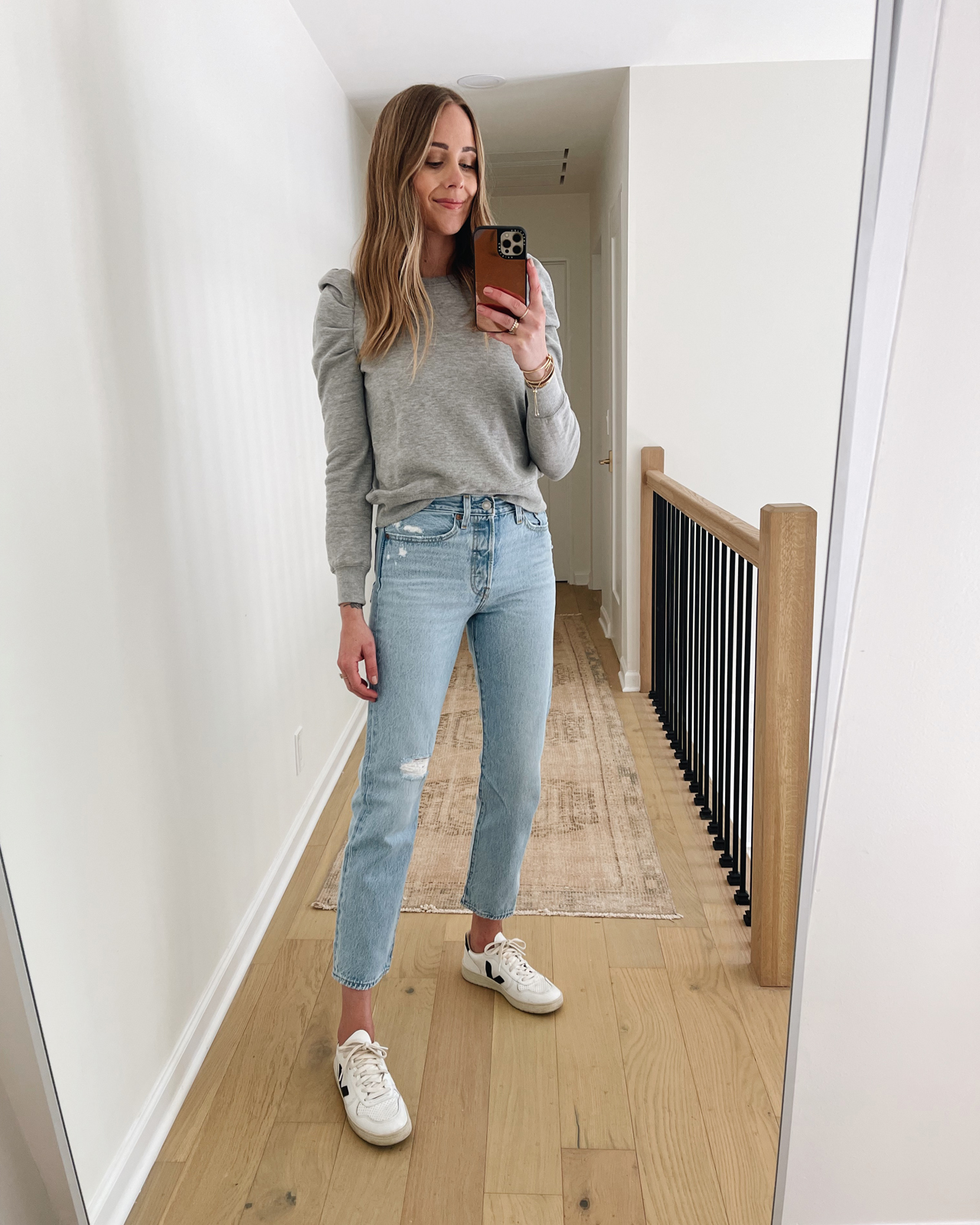 Fashion Jackson Wearing Levis Wedgie Straight Jeans Review Grey Puff Sleeve Sweatshirt Veja V10 Sneakers