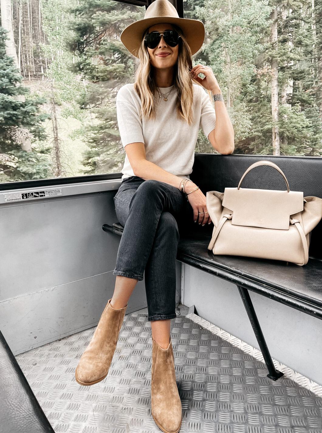Fashion-Jackson-Wearing-Tan-Wool-Hat-White-Short-Sleeve-Sweater-Black-Jeans-Tan-Suede-Booties-Celine-Mini-Belt-Bag-1440x1800