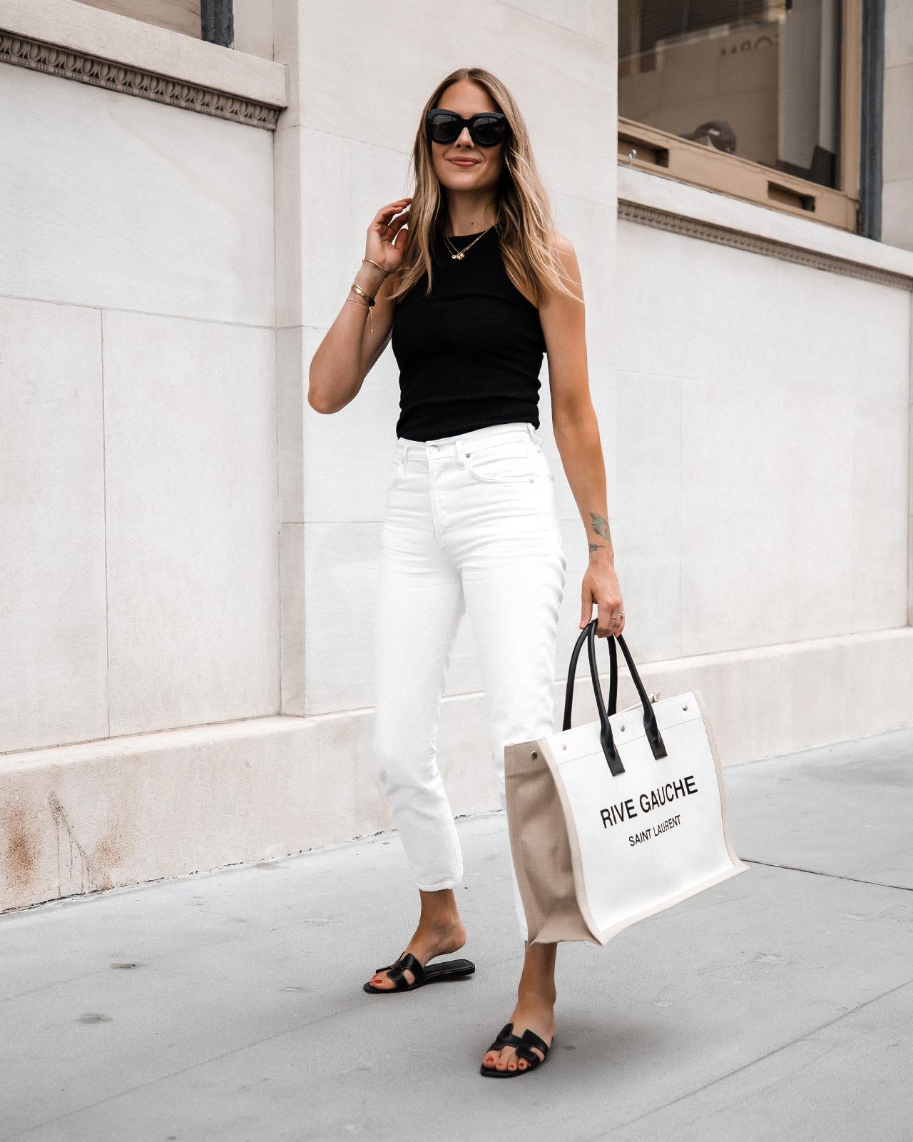 Fashion Jackson Wearing White Jeans with Black Tank Top Black Hermes Oran Sandals Saint Laurent Tote