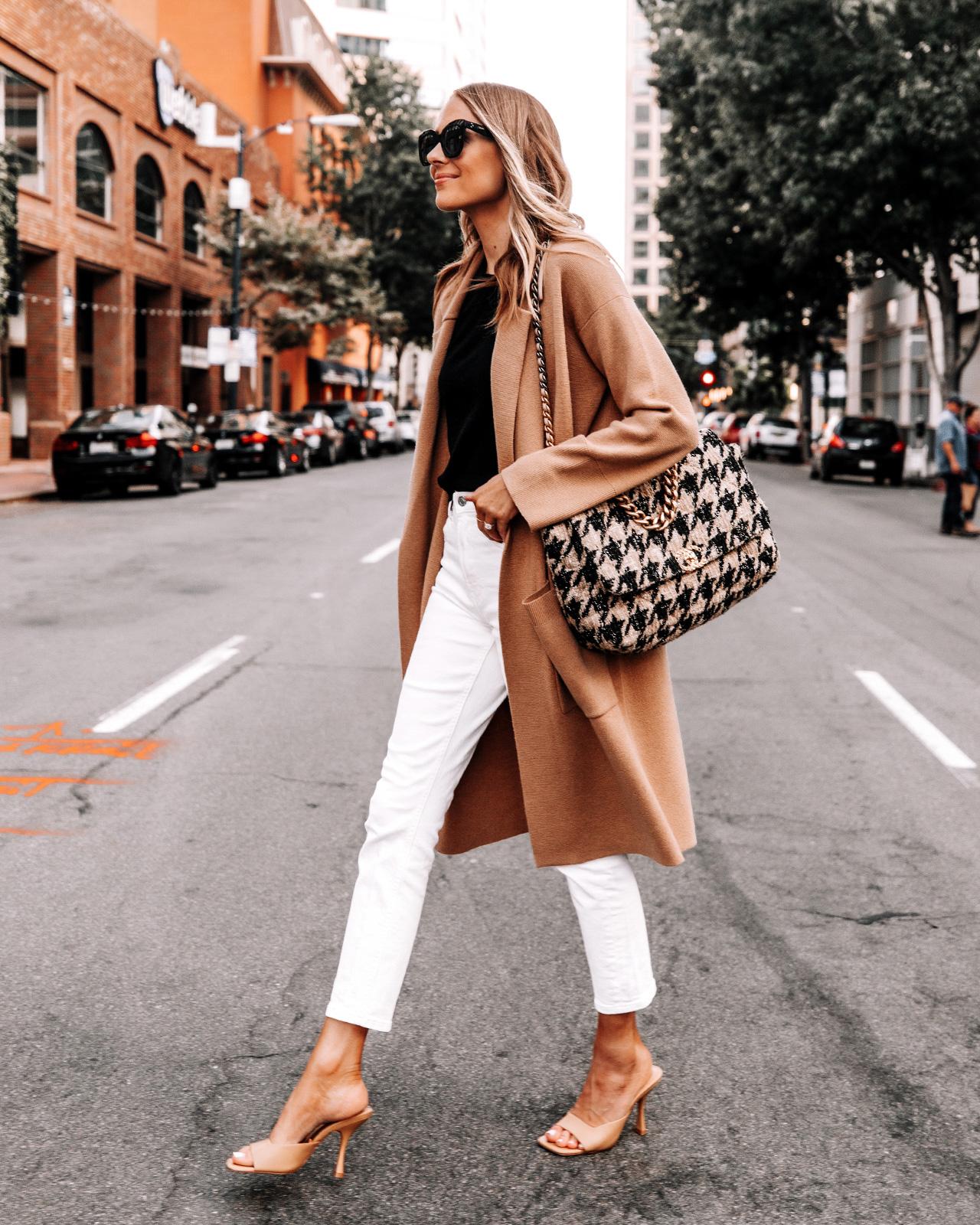 Fashion Jackson Wearing White Jeans with Camel Coatigan Black Sweater Tan Heeled Sandals Chanel 19 Houndstooth Maxi Handbag