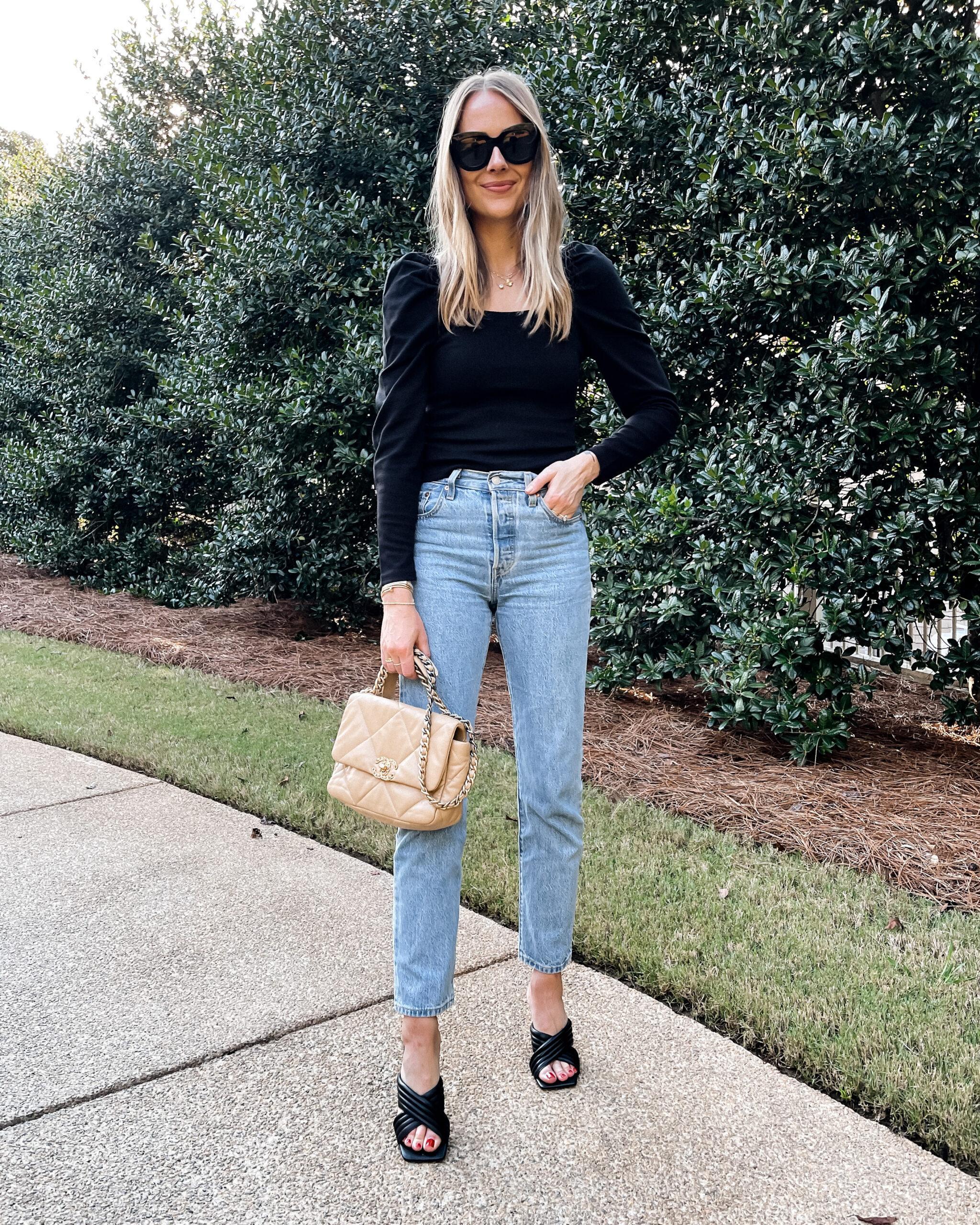Fashion Jackson Wearing Black Puff Sleeve Top Levis 501 Jeans Black Heeled Sandals Chanel 19 Beige Handbag