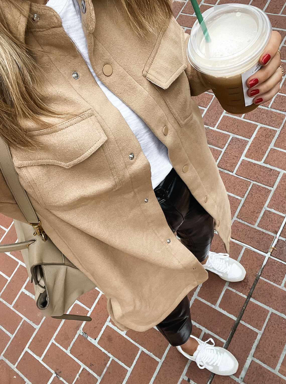 Fashion Jackson Wearing Abercrombie Long Tan Shacket White Tshirt Black Faux Leather Pants White Veja Trainers