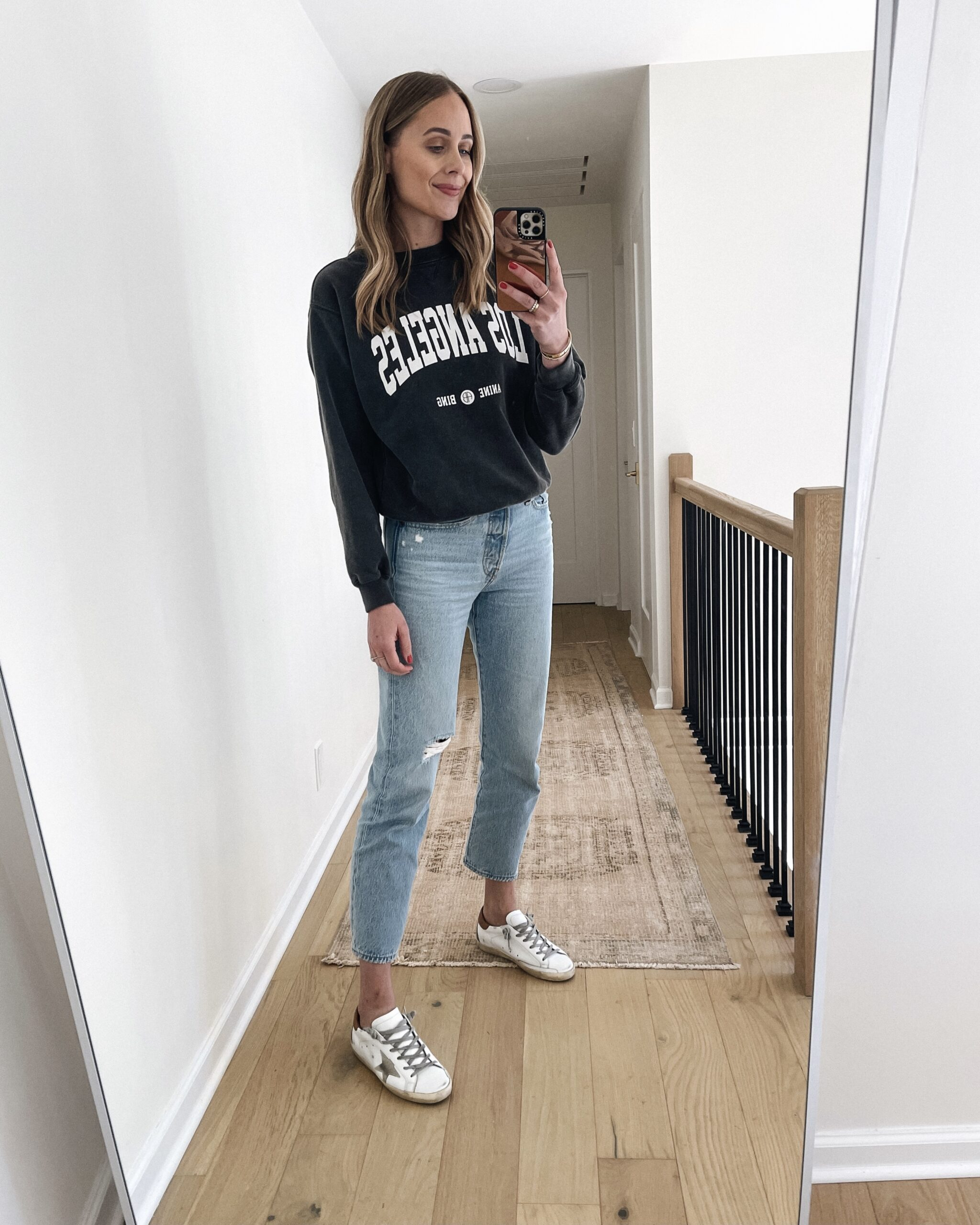 Fashion Jackson Wearing Anine Bing Los Angeles Sweatshirt Levis Jeans Golden Goose Sneakers