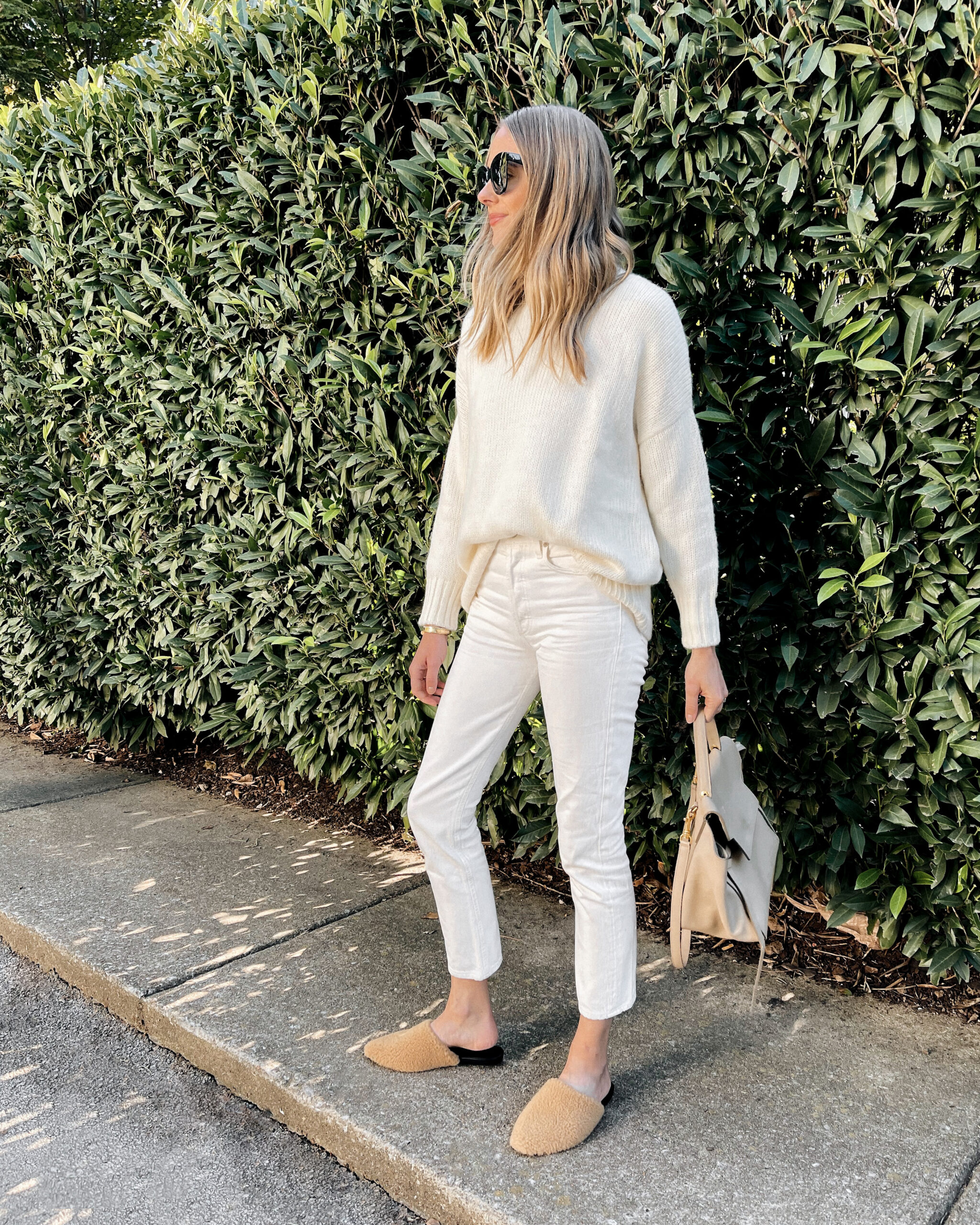 Fashion Jackson Wearing Jenni Kayne White Sweater White Jeans Beige Mules Celine Belt Bag