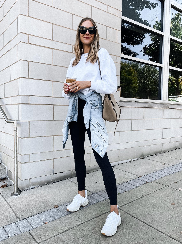 Fashion Jackson Wearing White Sweatshirt Black Leggings Denim Jacket White Veja Sneakers Fall Weekend Outfit