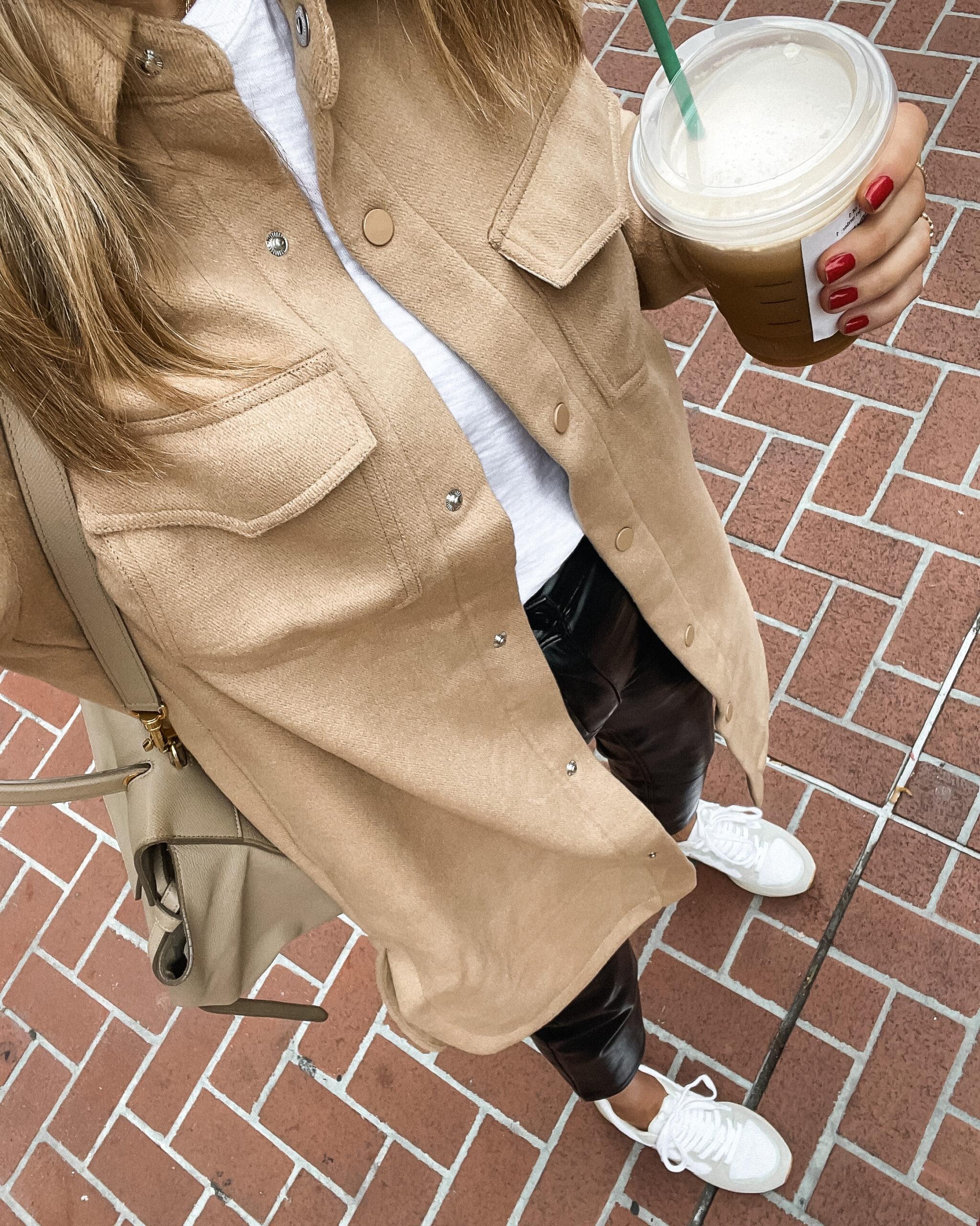 Fashoin Jackson Wearing Abercrombie Camel Long Shacket Black Faux Leather Pants White Veja Sneakers